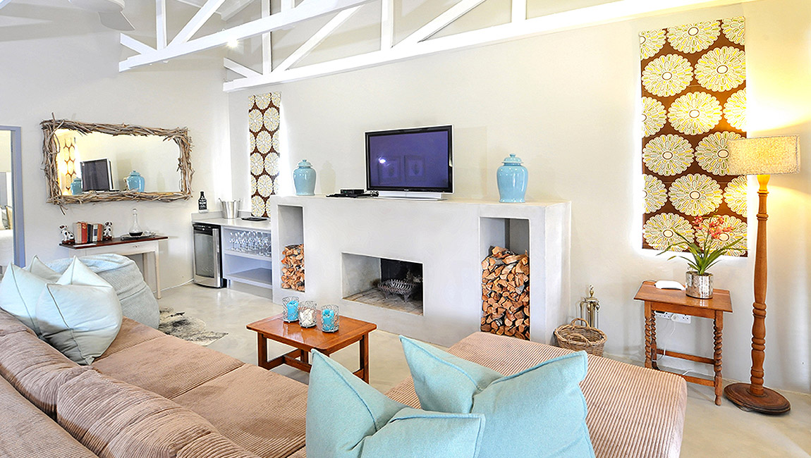 Our flat screen TV and fireplace make for a welcoming lounge